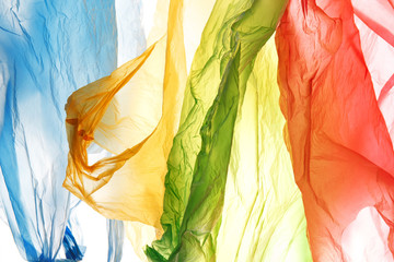 bright multicolored abstract background of used color polyethylene bags, environmental pollution concept Wall mural