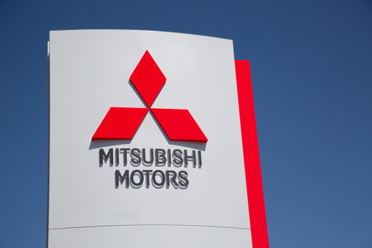Moscow, Russia - May, 2018: Mitsubishi motors automobile dealership Sign against blue sky. Mitsubishi is a japanese manufacturer of automobiles and commercial vehicles.