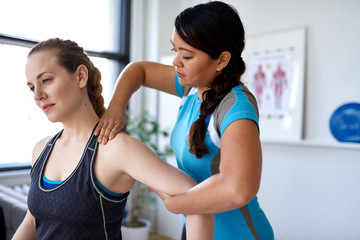 Chinese woman physiotherapy professional giving a treatment to a
