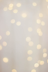 Wooden background with yellow bokeh bulbs.