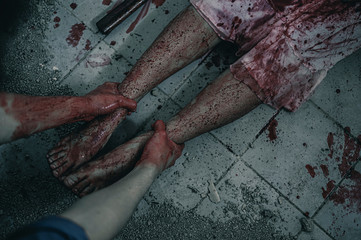 The woman was brutally being arrested and tortured in the leg. Women torture and need help, Halloween murder concept.