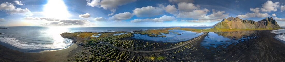 360 degrees Icelandic aerial landscape of the black sand beach in Stokksnes. 360 panorama of Vestrahorn mountain on a sunny day.