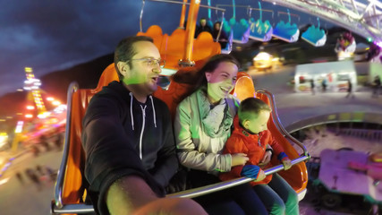 Printed kitchen splashbacks Amusement Park Parents and child having fun in amusement park, night entertainment