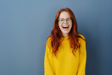 Young redhead woman with lovely sense of humor