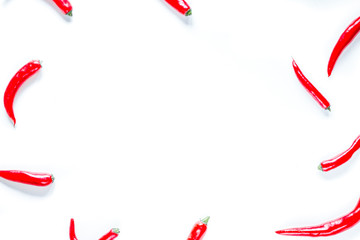 Canvas Prints Hot chili peppers red chili pepper frame design on white table background top view mock-up