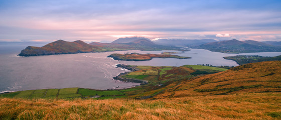 Fotobehang Purper Beautiful view landscape seascape sunrise morning sunlight Valentia Island Cromwell Point Lighthouse Portmagee Ring ok Kerry Ireland colors amazing splitting lights
