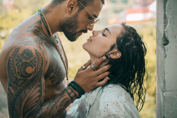 Obraz Young beautiful couple in love. Kissing couple. Trust him. Romantic and love. Sensual couple kiss. - fototapety do salonu