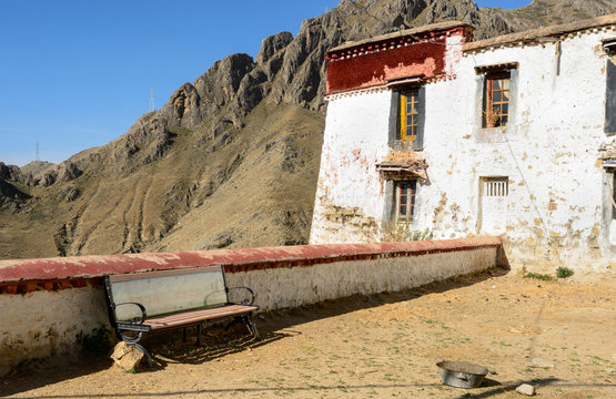A bench awaits a seeker of solitude at the Drepung Monastery in Lhasa, Tibet.