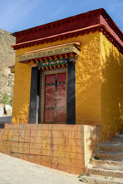 A bright yellow building adds color at Drepung Monastery in Lhasa, Tibet.