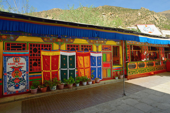 A gift store displays religious symbols and wares along a walkway at the Deprung Monastery in Lhasa, Tibet.
