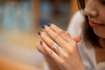 Close up of an elegant diamond rings on woman finger,(soft and sellective focus)