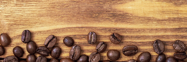 Coffee bean. The background of roasted coffee beans is brown on wooden boards. layout. Flat lay.