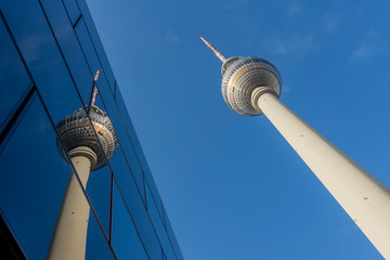 Beautiful urban reflections in the city center of Berlin, Germany, with a detail of the Tv Tower called Fernsehturm