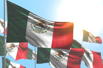 nice anthem day flag 3d illustration. - many Mexico flags are waving against blue sky picture with soft focus