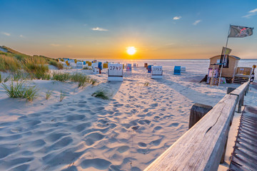 Wall Mural - Sunset at the beach on Juist, East Frisian Islands, Germany.