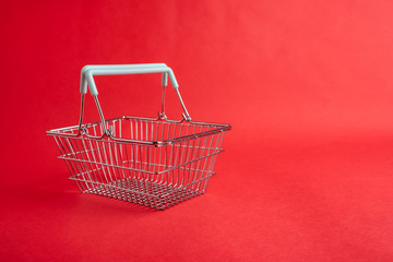 An empty shopping basket on a red background, shopping concept illustration