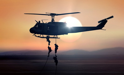 Poster Helicopter Military commandos helicopter drops during sunrise