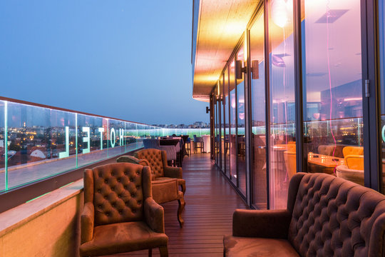 Interior of a rooftop hotel bar restaurant terrace