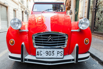 Red oltimer Citroen 2cv6 Special car, front view