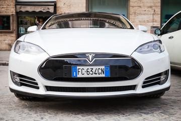 White Tesla model S car parked on roadside