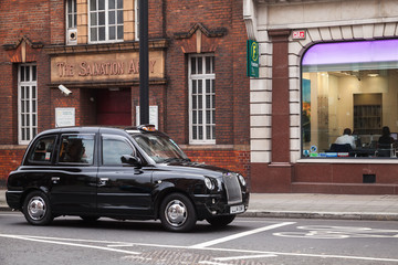 Black taxi cab by The London Taxi Company
