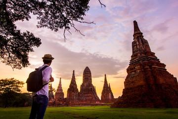 Fotobehang Bedehuis Young man travel in Ayutthaya Historical Park at Wat Chaiwatthanaram where UNESCO World Heritage Site