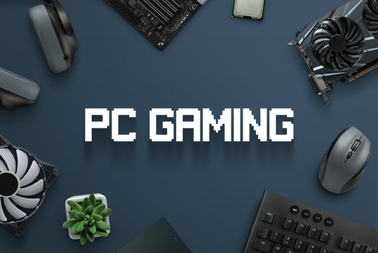 PC gaming concept scene with text and gaming computer components. Top view, flat lay, close-up.
