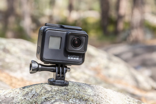 Fontainebleau, France - May 01, 2019: Illustrative image of an action camera GoPro Hero 7 Black outdoors on a rock in a forest.