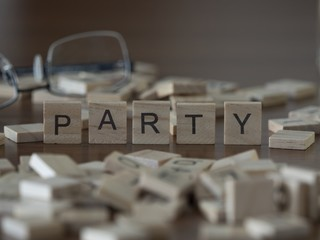 The concept of Party represented by wooden letter tiles