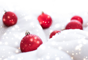 Red Christmas baubles on fluffy fur with snow glitter, luxury winter holiday design background