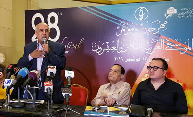 Egyptian poet Gamal Bekheet speaks during a news conference after the opening ceremony of the 28th Arab Music Festival at Cairo Opera House,