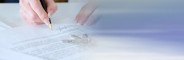 Client signing a real estate contract; panoramic banner