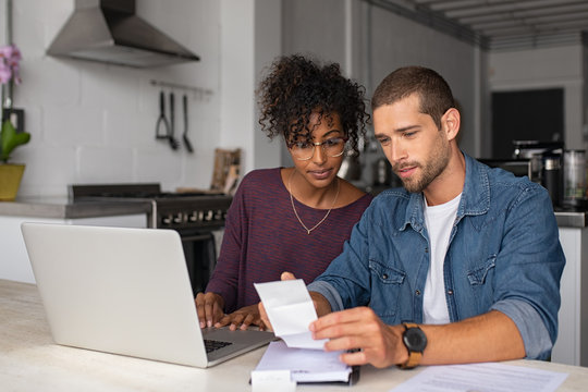 Young multiethnic couple examining home finance