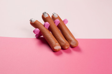 gradient pink background and sausage manicure