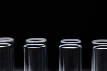 close up view of glass test tubes isolated on black