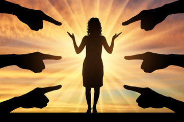 Silhouette of hands show at a woman standing on a sunset background