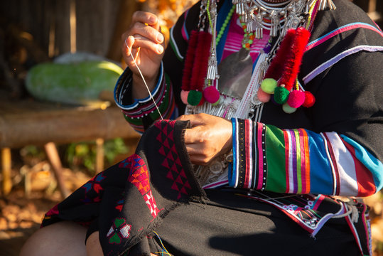 The Akha woman is sewing
