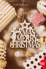 Obraz Studio shot of a beautiful decoration for christmas on a rustic blue background, top view, flat lay,snow sprayed above, christmas and winter holidays concept. - fototapety do salonu