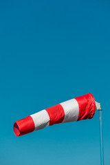 windsock in front of blue sky