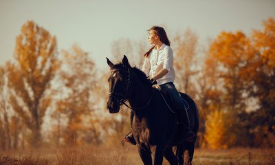 Young girl riding a horse.