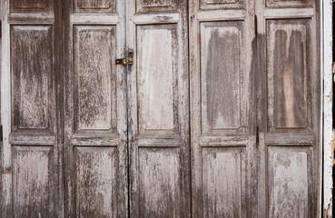 Old antique wooden doors in rural Thailand.