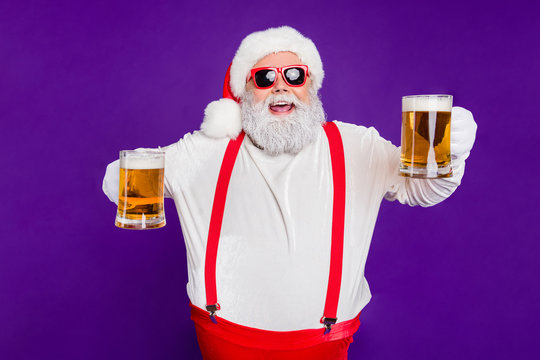 Portrait of nice drunk cheerful cheery glad bearded thick fat Santa having fun offering drinking beer night club bar isolated over bright vivid shine vibrant violet lilac background