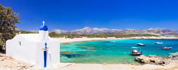 Traditional Greece - small church on the turquoise beach. Naxos island