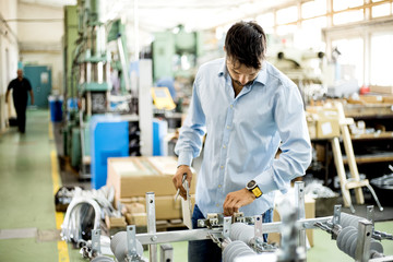 The engineer oversees the process of working in an electrical workshop,stock photo