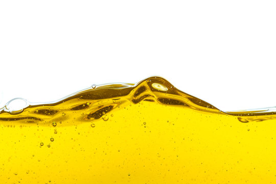 Beautiful wave of high viscosity of base oil and air bubble inside the oil isolated on white background, used as wallpaper, industrial concept