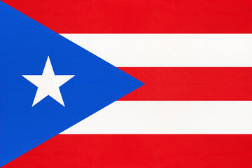 Puerto Rico national fabric flag, textile background. Caribbean state official sign.