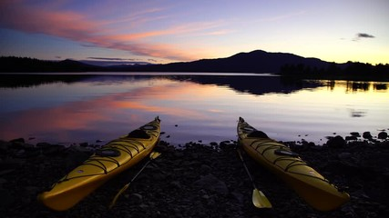 Fotomurales - Two kayaks on the shore of a lake during a tranquil dusk. Jamtland, Sweden.