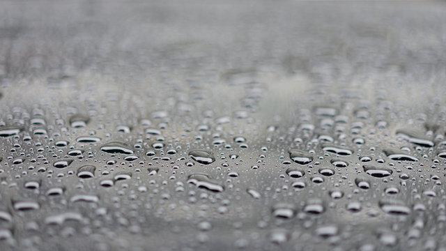 Water drops splash on the black floor, selective focus.