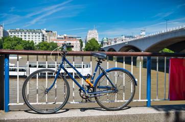 Deurstickers Fiets Parked bike along River Thames in London, summer season