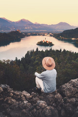 Traveling young woman looking at Bled Lake, Slovenia, Europe